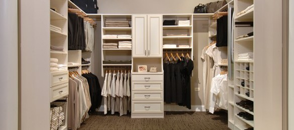 white closet with hanging clothes