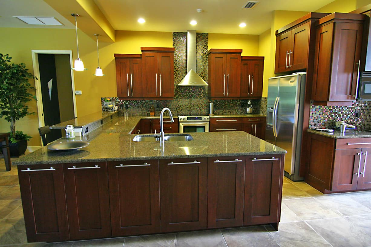 red wood kitchen with lots of countertop space