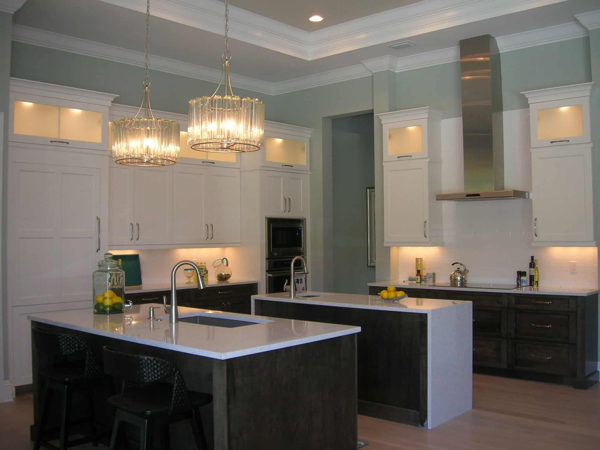 Modern White And Dark Wood Kitchen With Large Hanging Lights