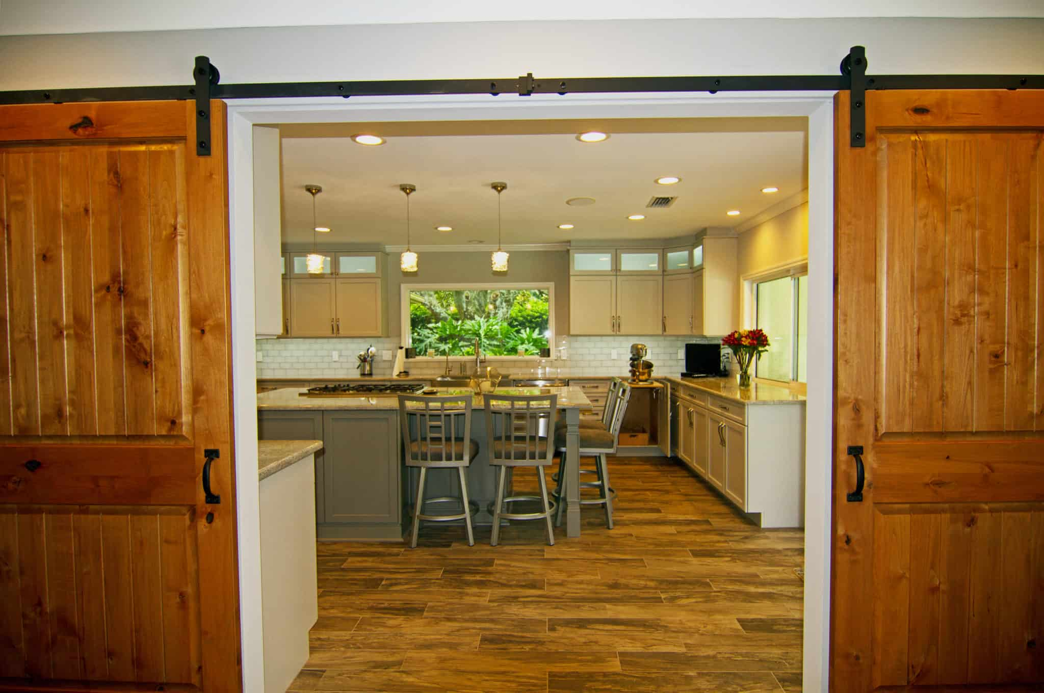farm doors leading to kitchen