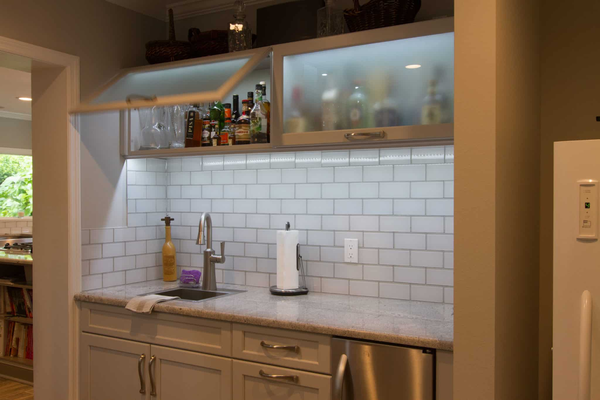 bar area with subway tiles