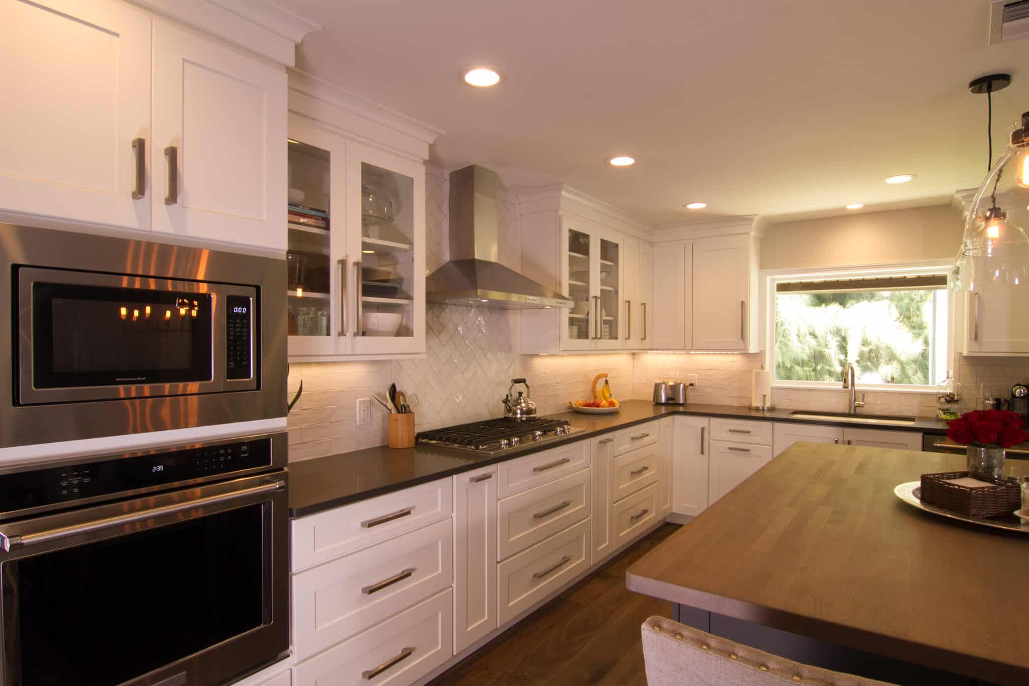 white cabinets and stell dual ovens