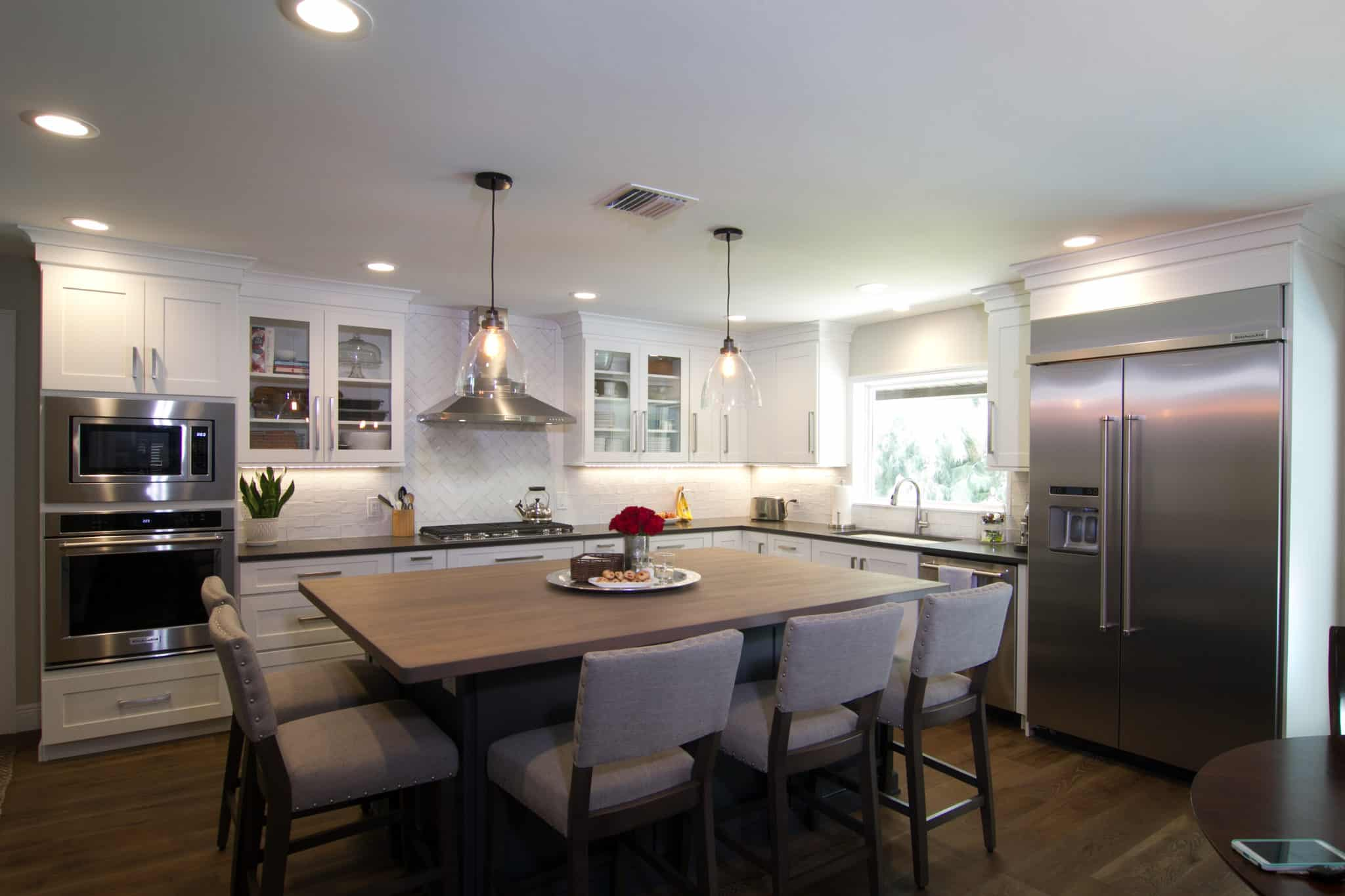 white cabinets with wood top island