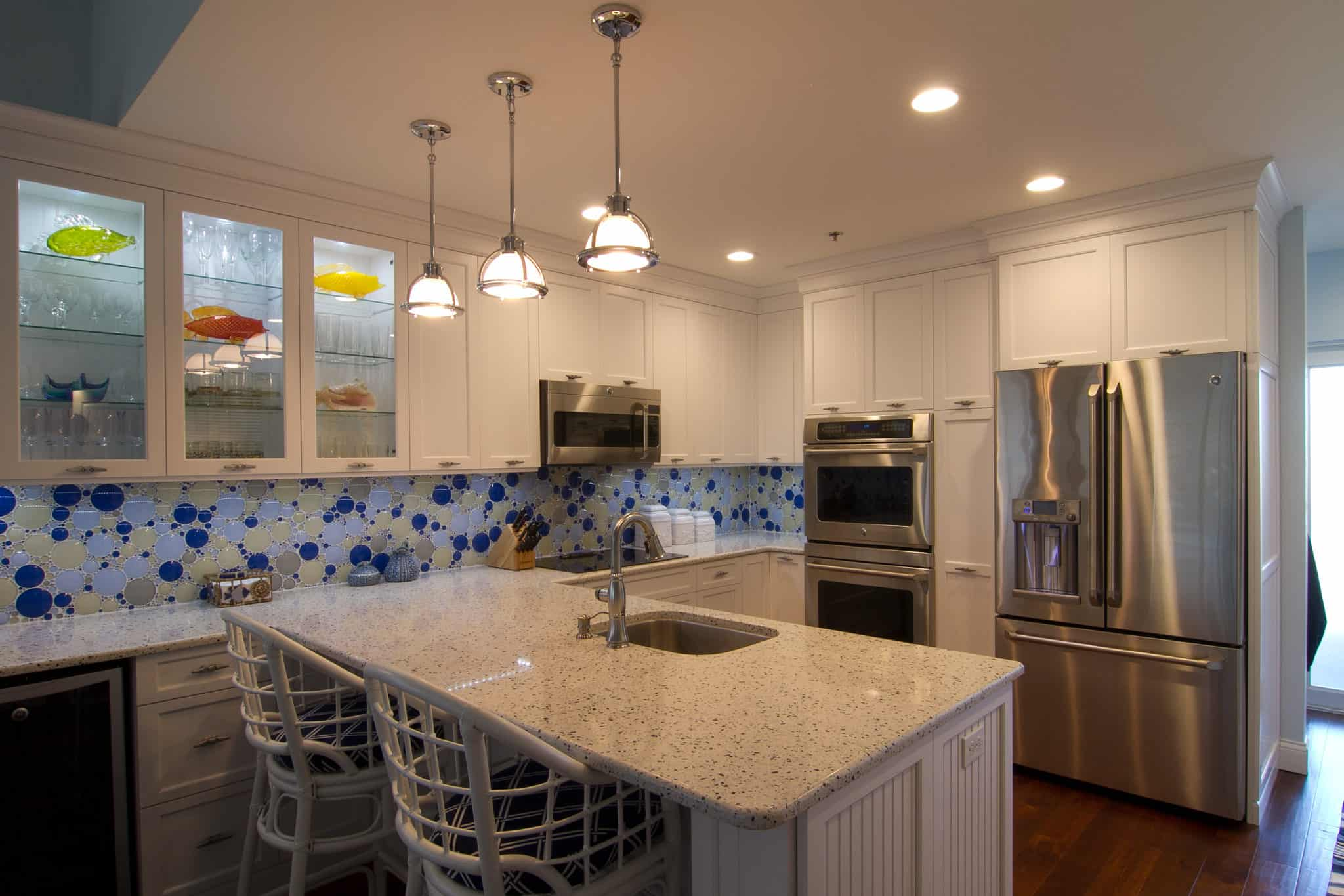 White kitchen with blue backsplash