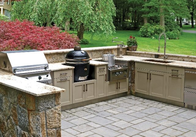 large outdoor kitchen on a tiled patio