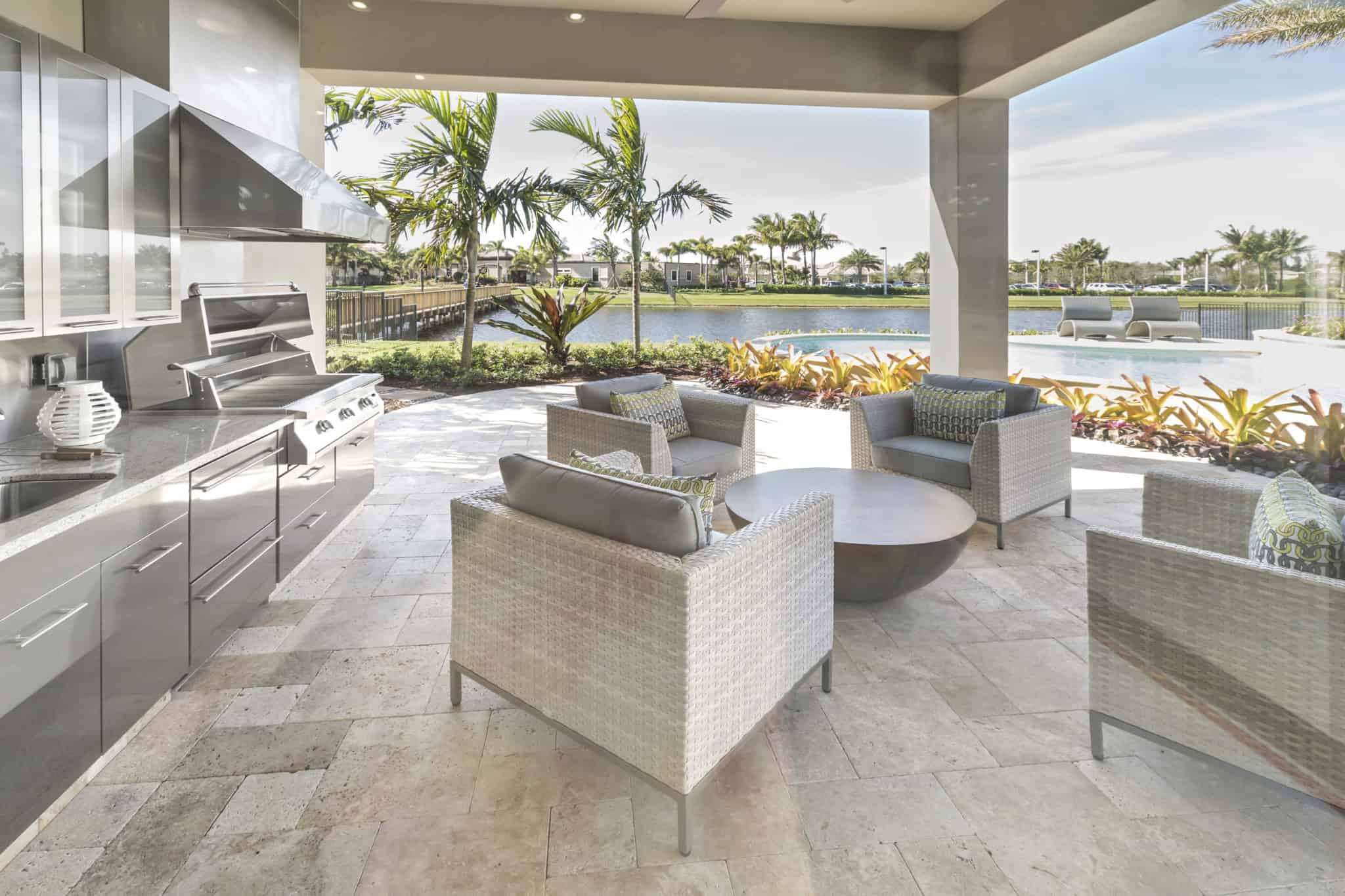 white outdoor kitchen built on large patio