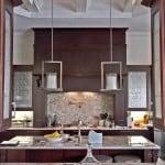 dark wood kitchen with glass cabinet doors